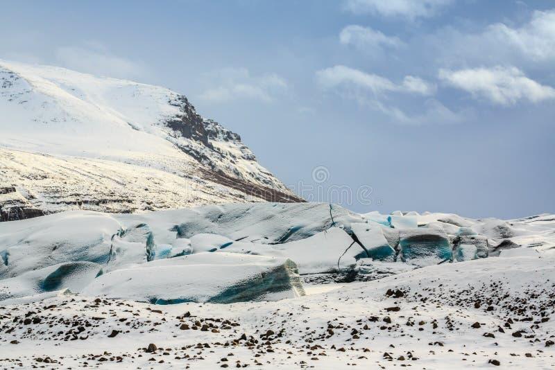 Svínafellsjökull Glacier. Storm clouds gathering over the blue fractured ice of the Svínafellsjökull Glacier, Iceland stock image