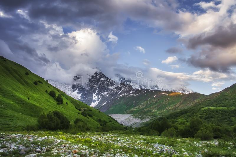 Svaneti mountain landscape, Georgia. Caucasus wild nature with snowy rocky mountains and grassy hills royalty free stock photo