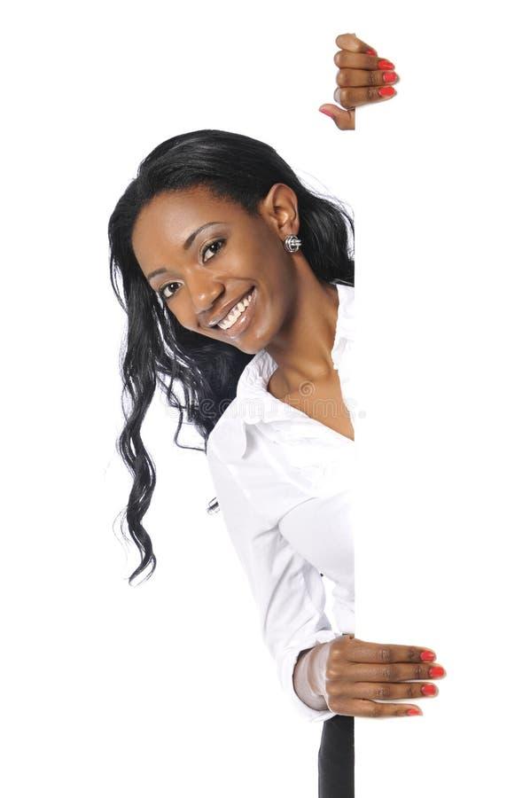 svart affärskvinnaholdingtecken royaltyfri bild