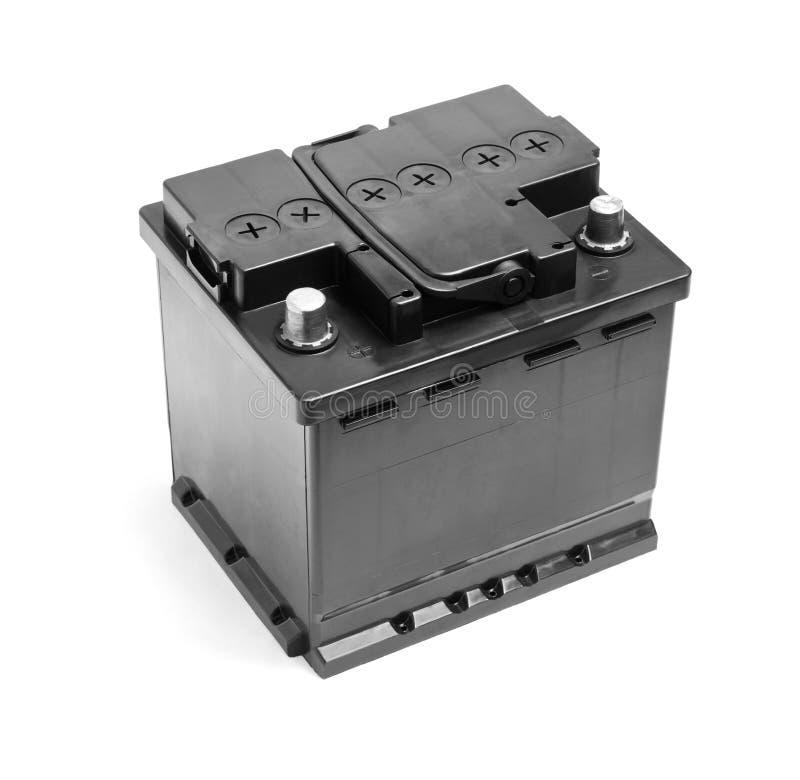 Svart bilbatteri som isoleras på en vit bakgrund royaltyfri bild
