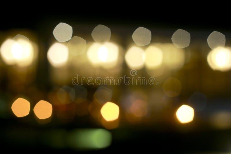 Svart blänker tappningljusbakgrund defocused royaltyfri bild