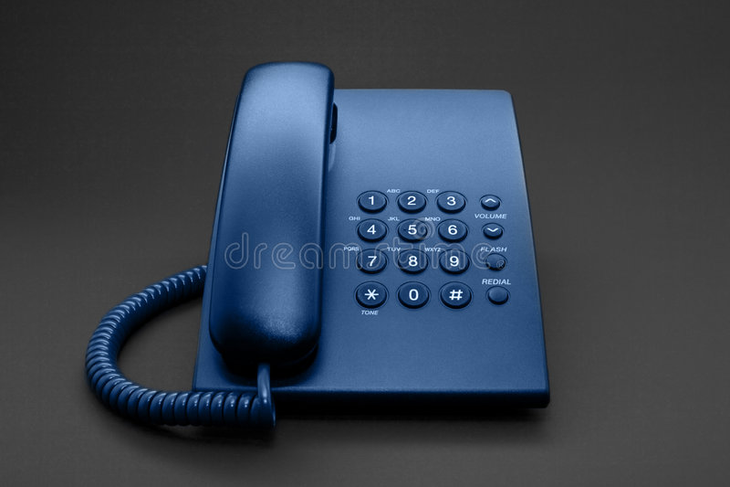 svart blå tonad kontorstelefon arkivfoton