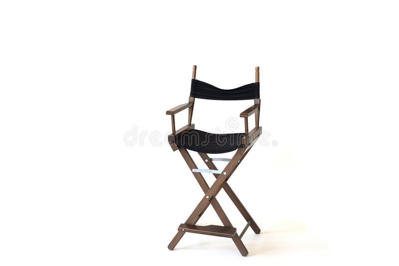 Svart direktörstolbruk i den video produktion eller filmen och biobransch Det är pålagd vit bakgrund isolerat arkivbild
