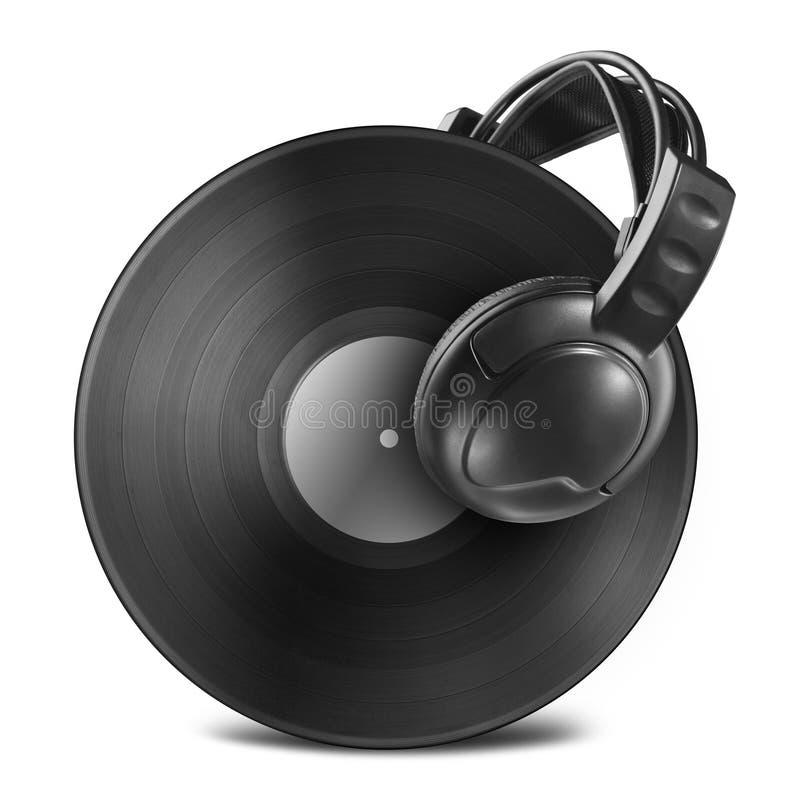 Svart diskett för vinylrekord med hörlurar som isoleras på vit royaltyfri fotografi