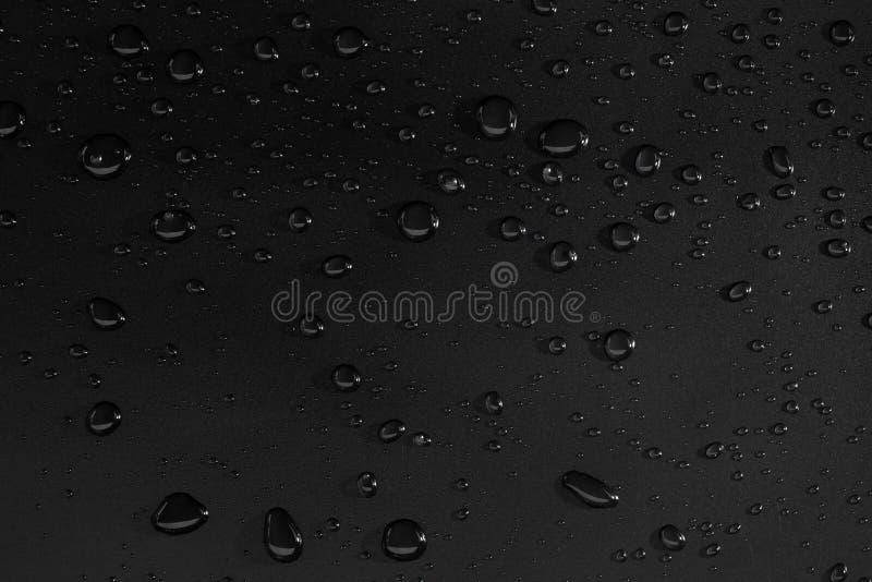 svart droppvatten för bakgrund arkivfoto