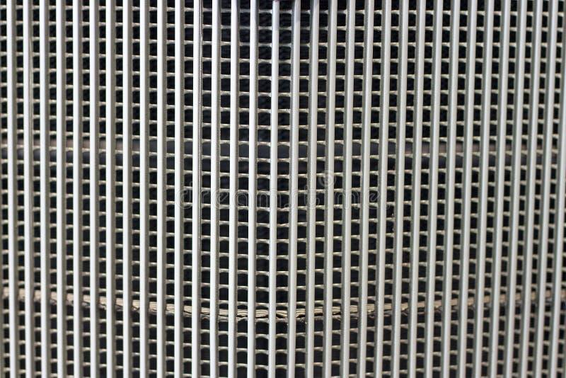 Svart elementskyddsgaller Raster av bilnärbilden, textur och bakgrund arkivfoto
