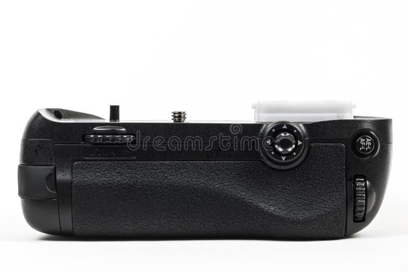 Svart för färg för fattande för DSLR-kamerabatteri som isoleras i vit tillbaka sikt royaltyfri bild
