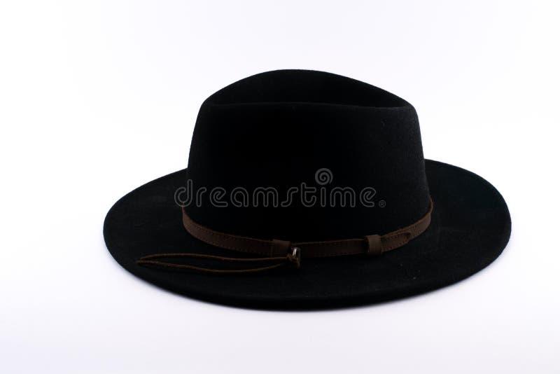 Svart Fedora hatt med ett brunt band arkivbilder