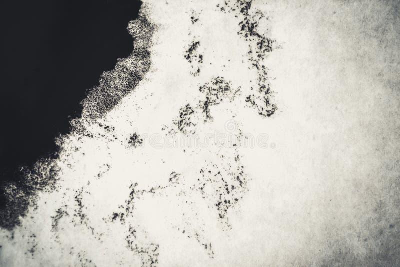Svart fläck på ett vitt bakgrundsfilter royaltyfri bild
