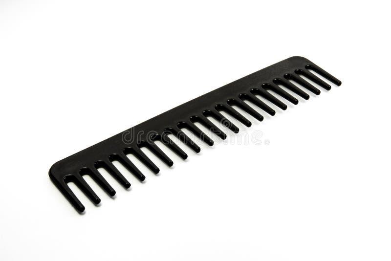 svart frisörhjälpmedel på vit bakgrund arkivbild