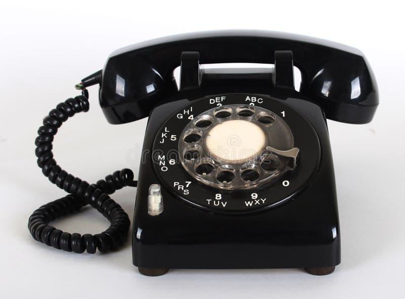 svart gammal telefon arkivbild