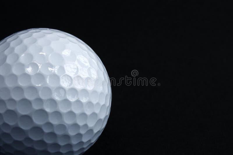 svart golf för boll arkivfoto