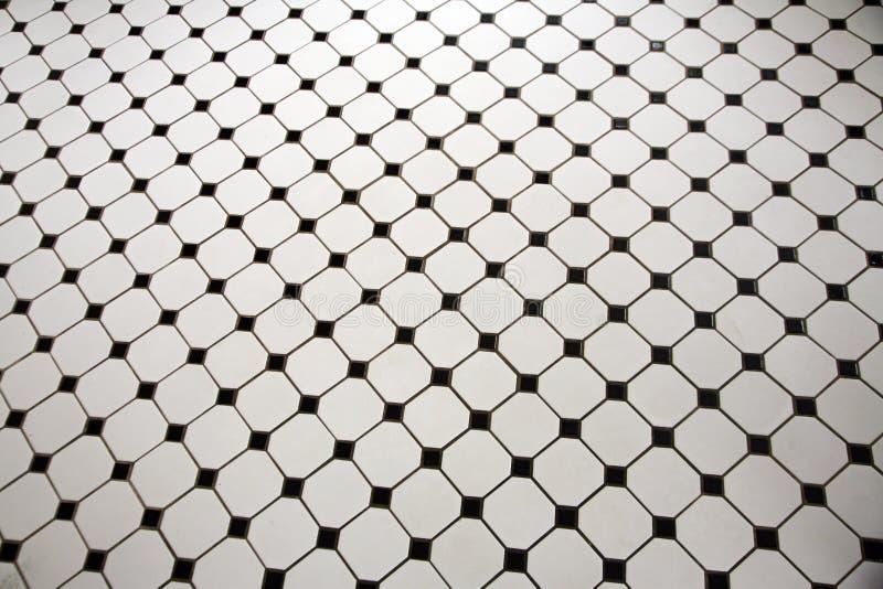svart golv belagd med tegel white royaltyfria foton