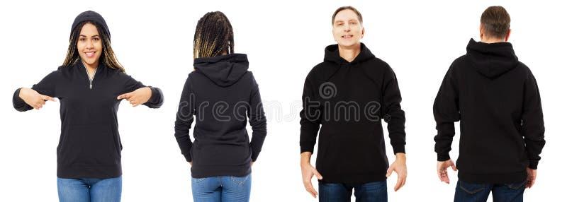 Svart härlig kvinna och medelålders man i svart hoodieåtlöje som isoleras upp på vit bakgrund royaltyfri bild