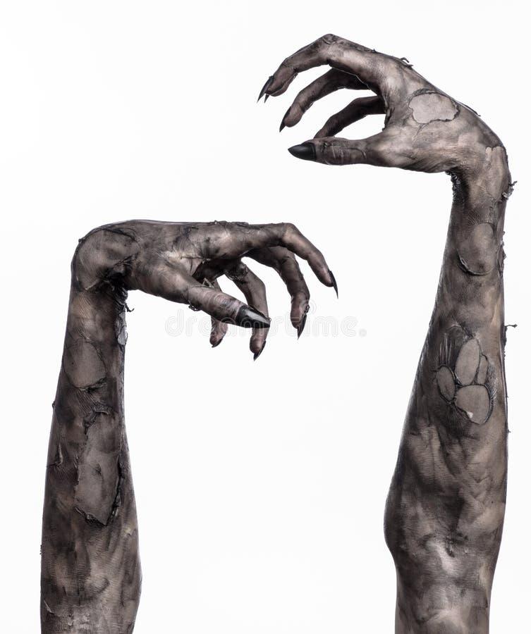 Svart hand av död, gå absolut, levande dödtema, halloween tema, levande dödhänder, vit bakgrund, mammahänder royaltyfri bild