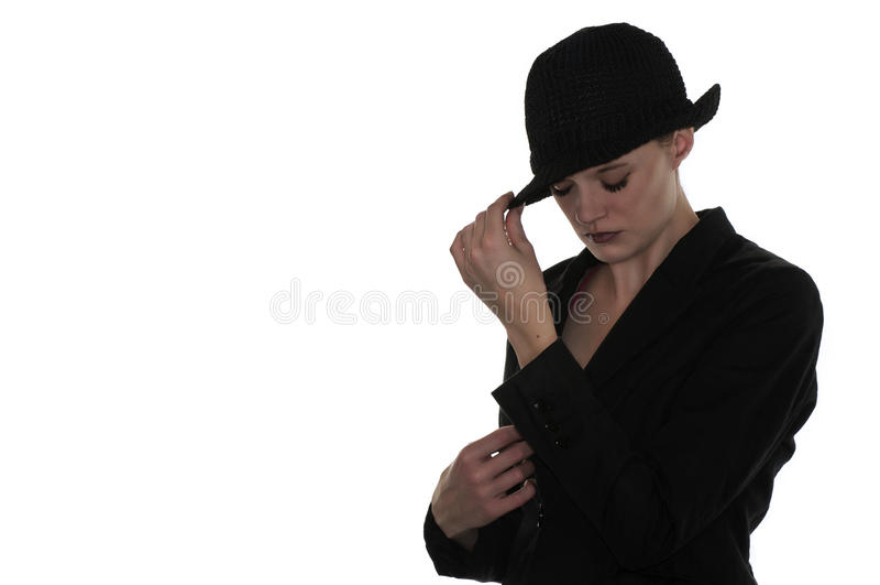 Svart hatt på gåtakvinna royaltyfri foto