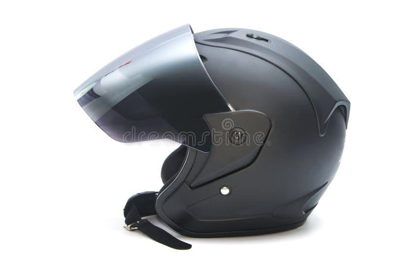 svart hjälmmotorcykel royaltyfri fotografi