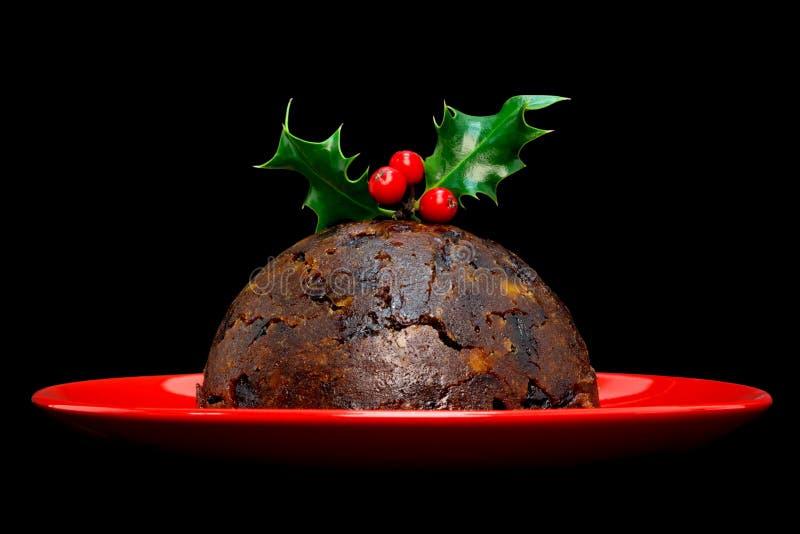 svart isolerad pudding för jul järnek arkivfoton