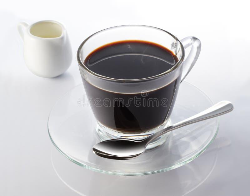 svart kaffe mjölkar royaltyfria foton