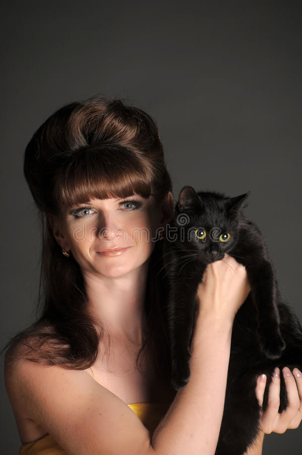 svart kattkvinnabarn royaltyfria foton