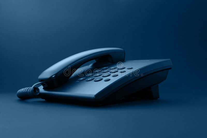 svart kontorstelefon royaltyfri foto