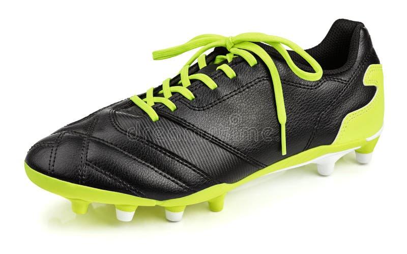Svart läderfotbollsko eller fotbollkänga som isoleras på vit fotografering för bildbyråer
