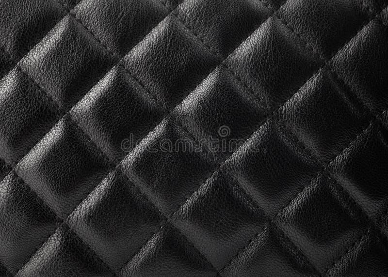 Svart läderstoppning royaltyfria foton