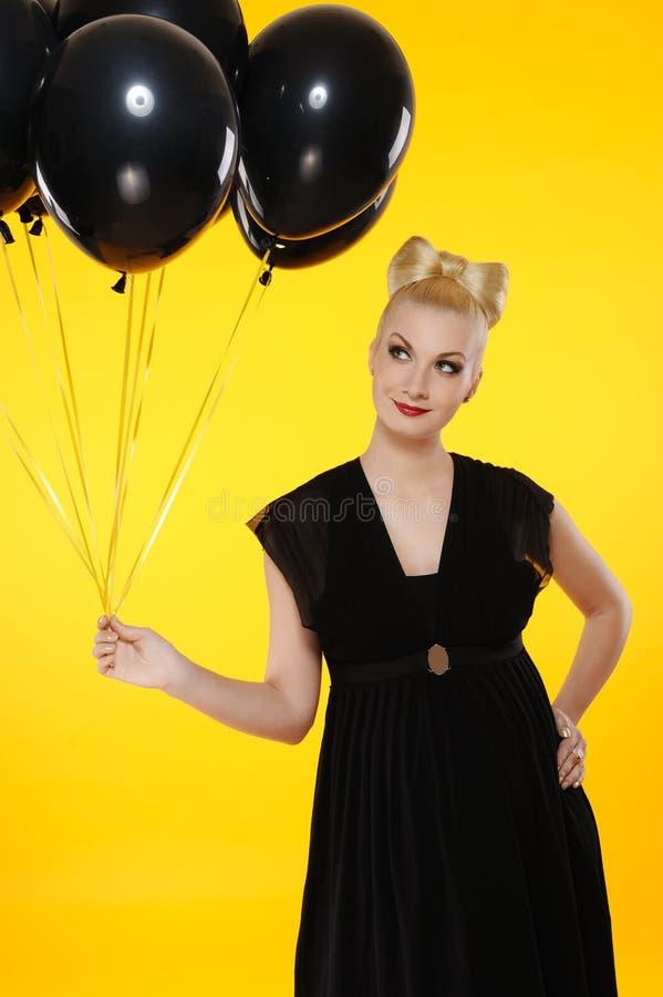svart lady för ballonger royaltyfri fotografi