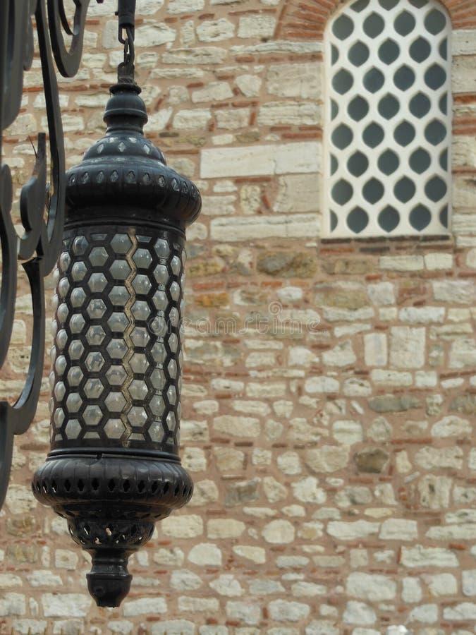 Svart lampa med mycket detaljer och hål royaltyfria foton