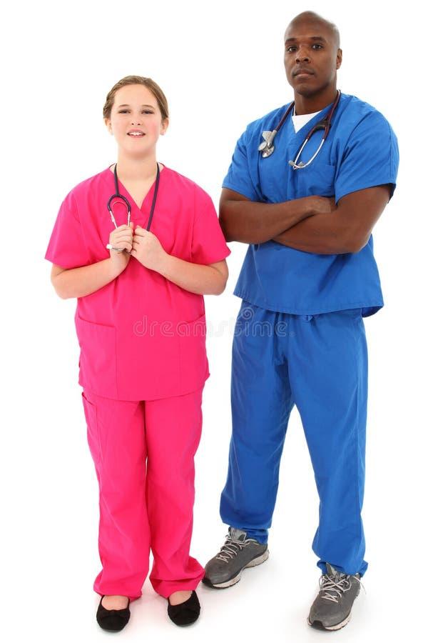 Svart Male sjuksköterska för doktor Med Barn Vit Kvinnlig fotografering för bildbyråer