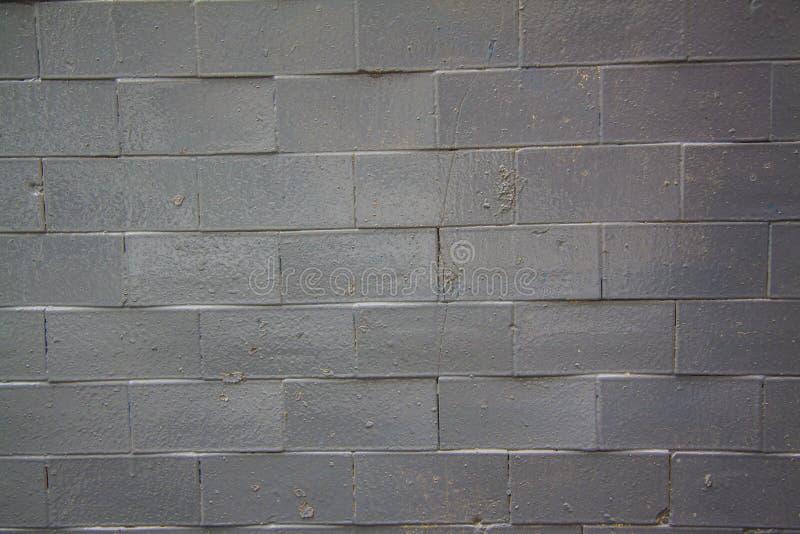 Svart ny tegelstenvägg - arkivbild