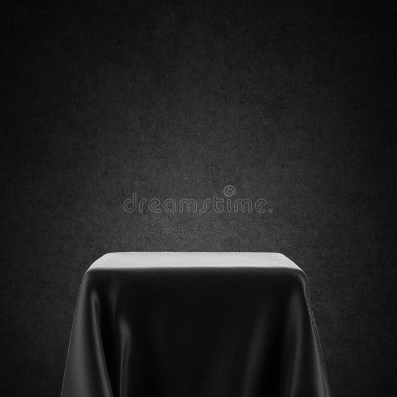 Svart och vitt spotlight-bord täckt med duk fotografering för bildbyråer