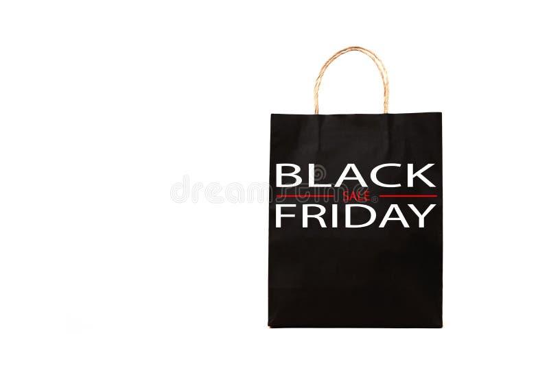 Svart pappers- påse med det svarta fredag ordet på vit bakgrund fotografering för bildbyråer