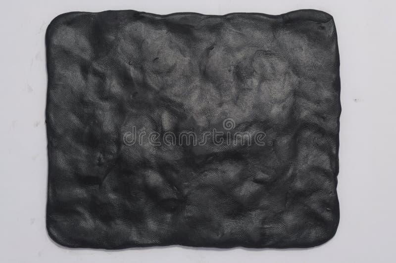 svart plasticine för bakgrund arkivfoto