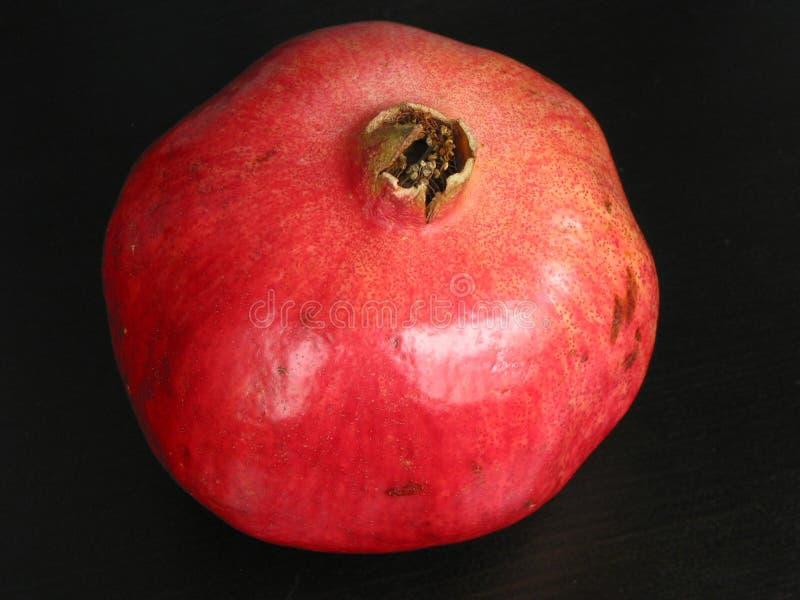 svart pomegranate för bakgrund royaltyfri fotografi