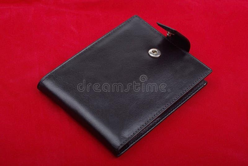 svart röd plånbok arkivbild