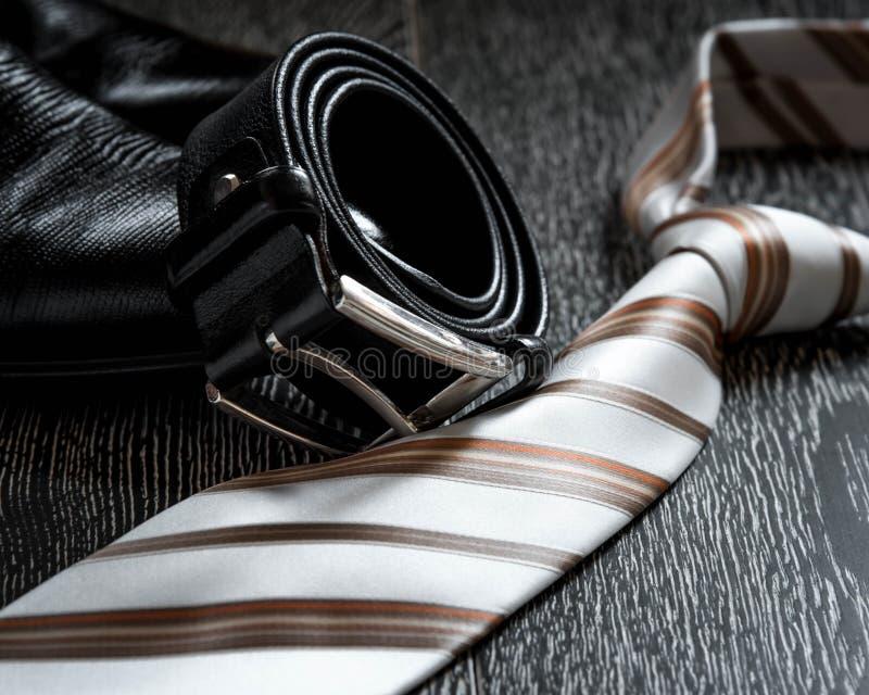 Svart rem och band för läderkänga arkivbild