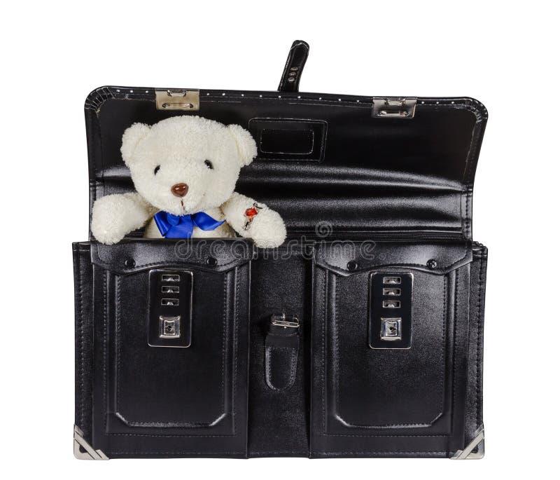 Svart retro läderskolväska med nallebjörnen som isoleras på vit royaltyfria foton