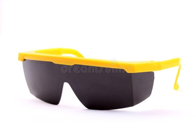 Svart säkerhetsskyddsglasögon för plast- arkivbild