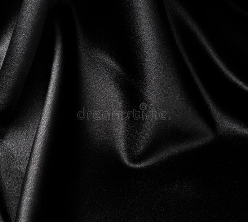 svart satäng royaltyfria bilder