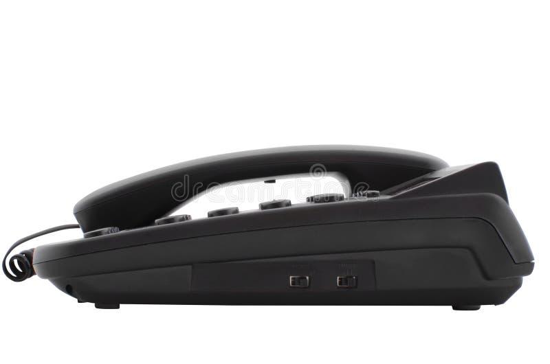 Svart skrivbordtelefon royaltyfri bild