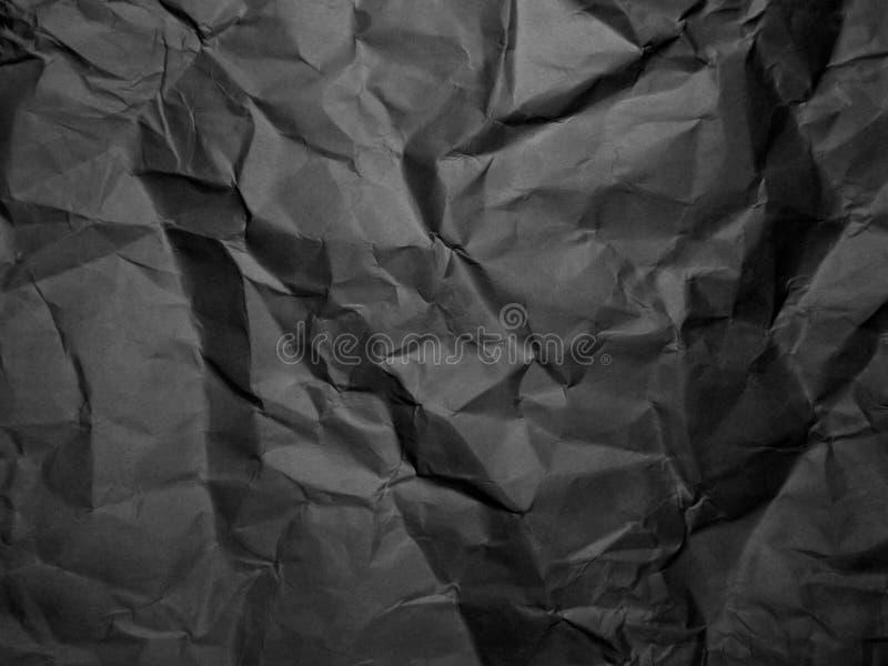 Svart skrynklade pappers- textur rynkat bakgrundspapper arkivbild