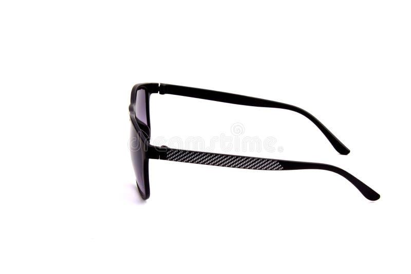 Svart solglasögon på en vitbakgrund arkivfoton