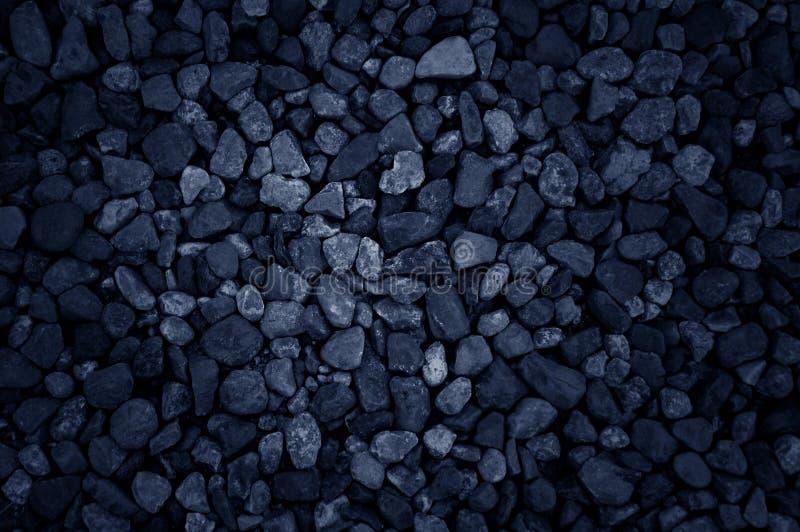 Svart stenar bakgrund arkivbilder