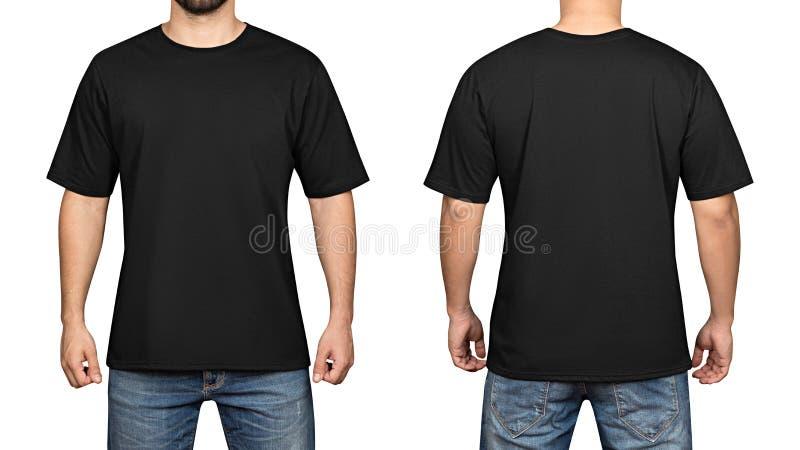 Svart t-skjorta på bakgrund, en framdel och en baksida för ung man en vit royaltyfria foton