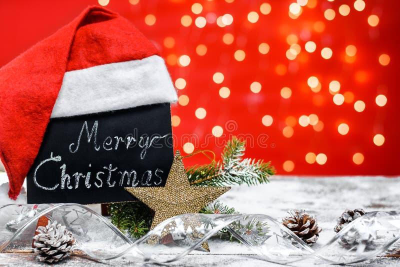Svart tavla med glad jul för text ' fotografering för bildbyråer
