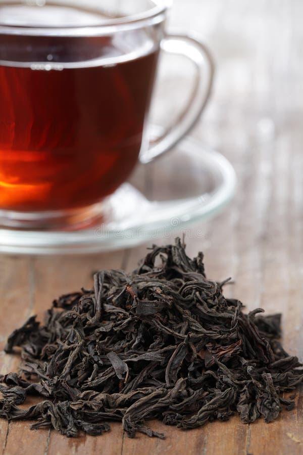 svart tea arkivfoton