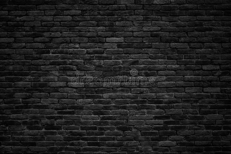 Svart tegelstenvägg, mörk bakgrund för design arkivfoton