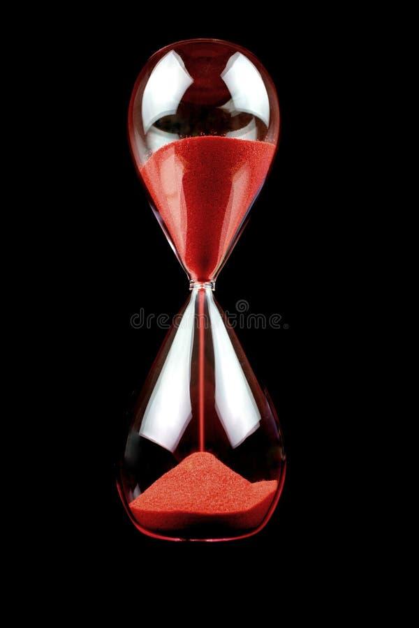 svart timglas för bakgrund arkivbild
