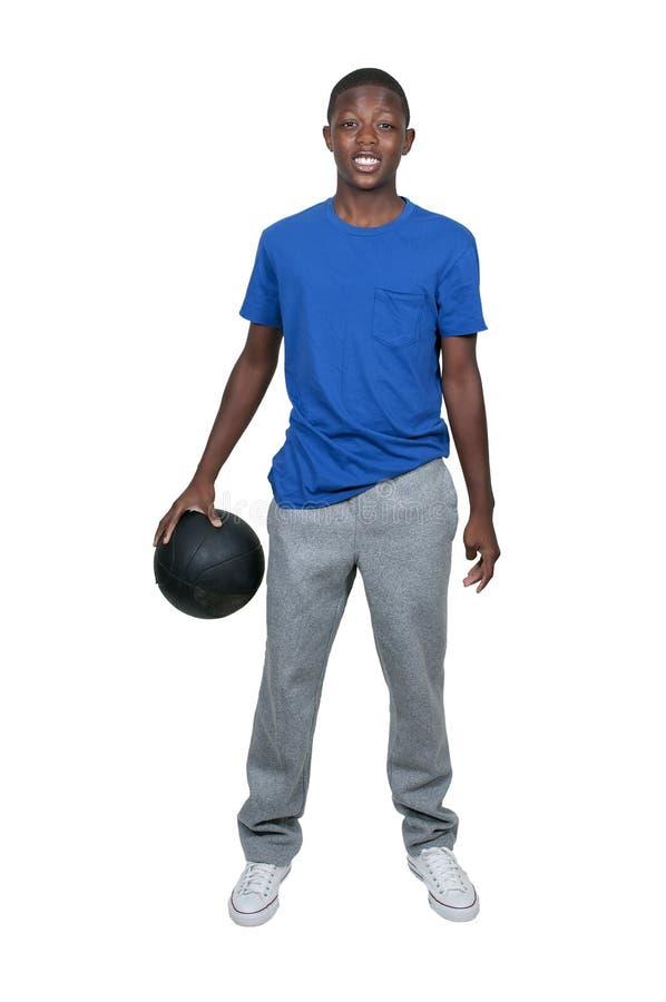 Svart tonårs- basketspelare arkivfoto